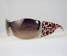"Enchanting Jewelry Creations - ""Uni-Lens Dark Giraffe Print Sunglasses"". ($18.00) (http://stores.enchantingjewelrycreations.com/uni-lens-dark-giraffe-print-sunglasses/)"