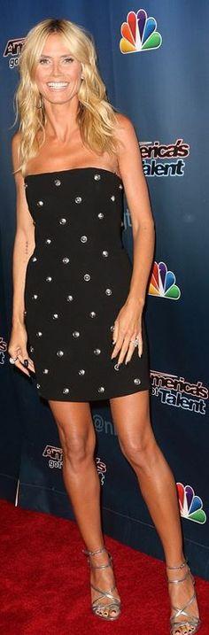 Who made  Heidi Klum's black strapless studded dress?
