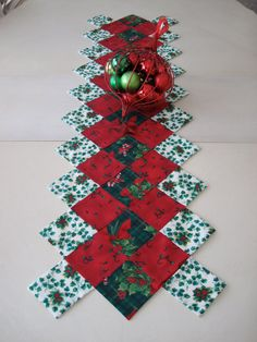 Quilted Christmas table runner - I like the unique shape and unfinished (though crisp) look.