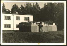 Sweden, A children's home, Dov Kole near a Sukkah he built for Sukkot, after the war.