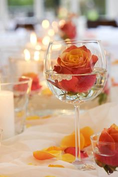 flower floating in a wine glass plus pearls centerpiece (grouping of glasses in middle of table) Pearl Centerpiece, Rose Centerpieces, Centerpiece Decorations, Renewable Sources Of Energy, Romantic Flowers, Deco Table, Small Patio, Simple Weddings, Flower Arrangements