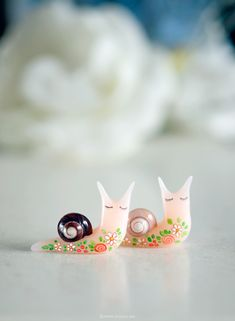 https://flic.kr/p/ztnySm | More tattooed snails, this time in translucent pink. Find them in my clay shop. | Blogged here