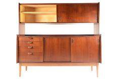 This wonderful modular Danish modern mid century teak credenza with hutch is the perfect versatile piece for any modern home. The credenza supports a teak sliding door hutch with two bays and adjustable shelves. Lower credenza features two sliding doors which open to birch lined, adjustable shelving and a bank of four drawers on the right. The case is supported by a quarter-sawn oak base. Recently refinished and in excellent condition.
