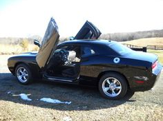 I'm thinking about changing to vertical doors on my Challenger.