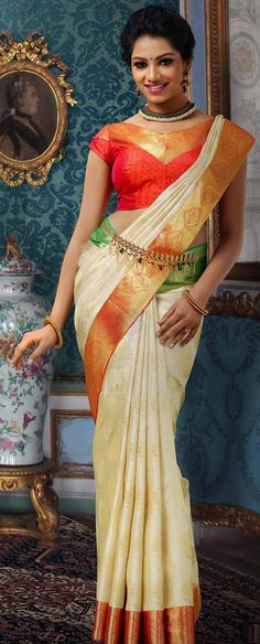 South Indian bride. Temple jewelry. Jhumkis.Cream silk kanchipuram sari.Braid with fresh jasmine flowers. Tamil bride. Telugu bride. Kannada bride. Hindu bride. Malayalee bride.Kerala bride.South Indian wedding