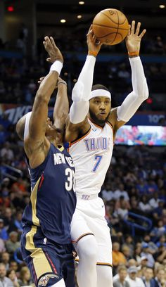 Oklahoma City\'s Carmelo Anthony (7) passes away from New Orleans\' Dante Cunningham (33) in the first quarter during a preseason NBA basketball game between the Oklahoma City Thunder and the New Orleans Pelicans at Chesapeake Energy Arena in Oklahoma City, Friday, Oct. 6, 2017. Photo by Nate Billings, The Oklahoman