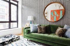 black/white wallpaper, green velvet sofa