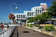 Vancouver - Canada Photograph - Promenade Quay At The Hotel by Alex Lyubar #AlexLyubarFineArtPhotography #NewWesnminster #FraserRiver #Quay #hotel #ArtForHome #FineArtPrints