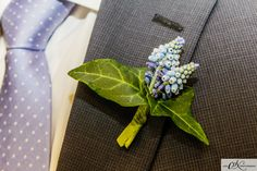 Boutineer/Boutinniere - A boutineer is a floral decoration worn by men, typically a single flower or bud. It is a flower on the lapel of a jacket.  It is worn on the left lapel of a men's suit, sport jacket, or blazer jacket; it can also be worn on an overcoat. The boutonniere is always attached above a man's heart, and it should be worn in the lapel's button-hole.