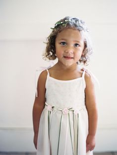 How sweet is this little flower girl?! http://www.stylemepretty.com/2015/11/16/sweet-summer-garden-wedding/   Photography: Nina and Wes - http://ninaandwes.com/