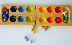 Wooden sorting tray of eggs in a color learning  and counting montessori style toy. $30.00, via Etsy.