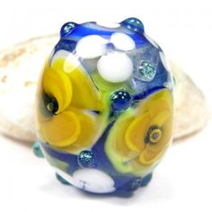 For the Jeweler in our life. A superb focal bead radiating colour and quality.  This is a fun piece to incorporate into any necklace you plan to make!