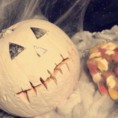 A PUMPKIN DESIGN & PARTY IDEA USING NAIL ACCESSORIES 🎃💅🏼  • 🎃 Sprayed average size pumpkin with white paint spray  🎃 Let it dry for an hour  marked out the mouth with a pen & carved out  🎃 Drawn out the eye & nose shape used my #silverleaf i use for #nailart and stuck on with nail glue 🎃 Glitter Chunks on Top  (See my Facebook & Instagram for More pics/videos )