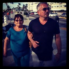 Cesar walking with his mother over the weekend in Mazatlán.