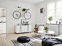 A very cool Swedish space (with a bike!). Stadshem.
