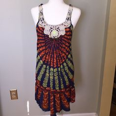 Free People Racerback Tunic S Amazing colorful tunic that is so super soft! Braided rope Racerback and pretty beaded and embroidered bodice. The bottom hem has an unfinished boho edge. Size small could also fit M. 100% cotton, made in India. Free People Tops Tank Tops