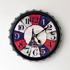 Unique large wall clocks are an easy way to bring life to a boring space.  In fact large modern wall clocks are extremely popular right now as not only do they look timeless but also serve as large decorative wall art!    Aiar Creative iron beer Cap wall clock Eiffel Tower wall clock wall clock with painted home decor