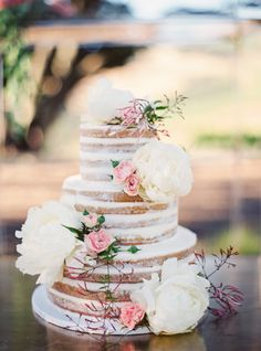 Three tier naked wedding cake topped with peonies: http://www.stylemepretty.com/2017/02/02/childhood-friends-turned-soulmates-wed-in-wine-country/ Photography: Jessica Burke - http://www.jessicaburke.com/