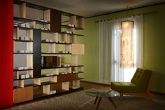 Babilonia bookcase with Daphne armchair and Boomerang table