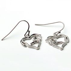 Horse As Heart Earrings.   The Kelley Horse As Heart Earrings is a perfect gift for any horse lover. Silver hook style earrings.  The KelleyHorse As HeartEarrings