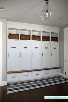 Like the baskets on top, closed drawers below. Possibly no need for doors for each space