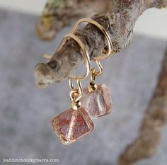 Earrings featuring simple loop beaded dangles