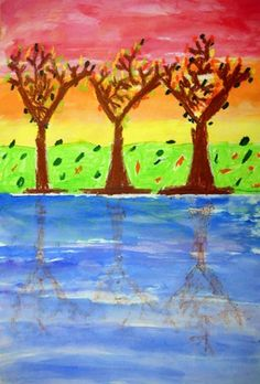 Oil pastel trees on top half of paper, folded and rubbed for reflection.  Water color on top.  Good water color experience for this grade.