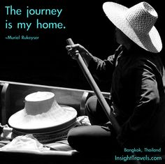 The journey is my home.  Boat woman in the shadows in a hat, Bangkok floating market, Thailand.  InsightTravels.com