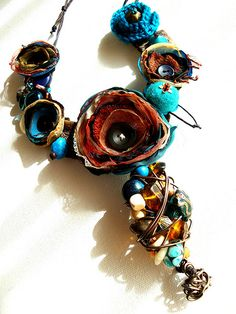 Chunky fabric flower necklace with beads, buttons and wire.