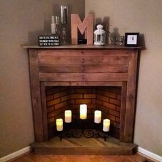 Check out this project on RYOBI Nation - We purchased our very first home last September (2015) and have been working to make it our cozy retreat ever since. We had a corner of our living room that was empty, except for some wall outlets on either side, but we couldn't seem to find the perfect piece to place there. That is, until we had the idea to use up a pallet some friends had given us! It is the first piece of 'furniture' that we have built together and was a fun learning experience (with a Pallet Fireplace, Faux Fireplace Mantels, Fireplace Remodel, Modern Fireplace, Living Room With Fireplace, Fireplace Ideas, Mantles, Corner Fireplaces, Fireplace Candles