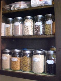 Organizing a pantry with glass jars is cheap and easy.  Used this idea for my own pantry.