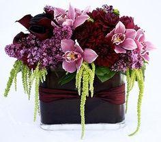 Unusual burgundy and lavender centerpiece with calla lilies, cymbidium orchids, hanging amarnthus, wax flower - Deep Roots Wax Flowers, Table Flowers, Beautiful Flowers, Wedding Flowers, Orange Flowers, Tropical Flowers, White Flower Arrangements, Table Arrangements, Floral Centerpieces