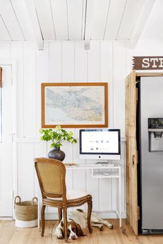 This work space is squeezed between the front door and the refrigerator. Dressed the plain, stainless steal appliance up with barnwood and help the desk blend in by painting it the same shade as the wall.
