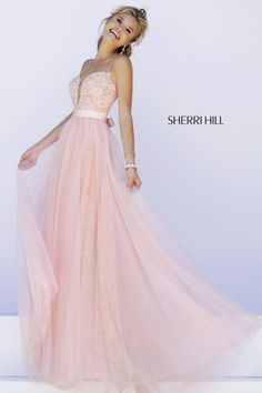 """Sherri HIll #32229 - Spaghetti straps hold up the fitted lace bodice with deep """"V"""" plunge in back and front. A full length lace skirt shows through layers of tulle while a satin bow cinches the waist."""