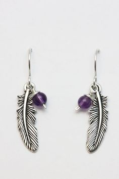 Silver pewter Feather charm with 4mm semi precious stone bead on sterling silver shepherd hooks. Feathers are symbolic of new beginnings, hope and freedom. Choose your bead to add your own special meaning.  Amethyst stone shown in photo.  See photo 2 for bead colour reference and stone meanings. Contemporary Furniture Stores, Special Meaning, Amethyst Stone, Stone Beads, Pewter, Diy Jewelry, Feathers, Hooks, Freedom