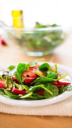 Light, refreshing and sweet, this salad is sure to bring you good vibes and make your taste buds happy. Ingredients: 1/4 cup olive oil, 3 tablespoon red wine vinegar, 2 tablespoon honey, 2 teaspoon poppy seeds, 4 ounces fresh baby spinach, 2 cups sliced fresh strawberries, 1/3 cup sliced almonds