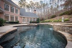 LOCATION: 123 Russell Road, Roswell, GA SQUARE FOOTAGE: 8,231 BEDROOMS & BATHROOMS: 6 bedrooms & 8 bathrooms PRICE: $1,265,000 This brick home is located at 123 Russell Road in