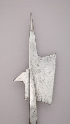 Halberd | Swiss | The Met Date:probably third quarter 15th century Culture:Swiss Medium:Steel, wood (oak), iron Dimensions:L. 75 3/4 in. (192.3 cm); L. of head 16 3/4 in. (42.6 cm); W. 8 in. (20.3 cm); Wt. 5 lbs. 10 oz. (2550 g) Classification:Shafted Weapons Credit Line:Gift of Stephen V. Grancsay, 1942 Accession Number:42.50.17