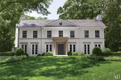 With a new limestone portico and a fresh coat of cream-color paint, Kasler's house now possesses the mien of an English Regency mansion.