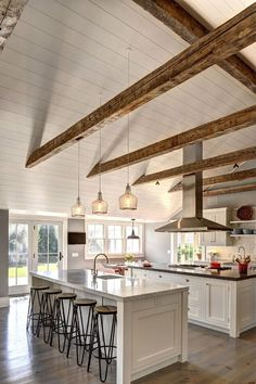 Ranch Cottage with Transitional Coastal Interiors. The kitchen feels spacious with its beamed cathedral ceiling and double islands. #kitchenislands #coastalcottageinteriors