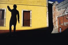 Alex Webb. 1987. Child and statue