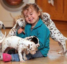 the Dalmatian is usually reserved towards unknown people and acts scrappy toward strange dogs, it is good around horses and other pets. may also be too lively and active for young children. Dogs And Kids, Animals For Kids, I Love Dogs, Puppy Love, Baby Animals, Cute Animals, Cute Baby Girl, Cute Kids, 3 Kids