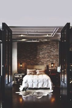 this bedroom is amazing* brick* contrast* rug* gorgeous* trunk nightstand*