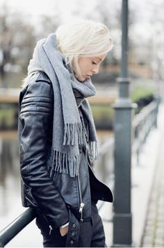 Lighten up an edgy all black outfit with a grey scarf.