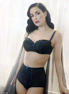 Looking good: Dita has just unveiled her new lingerie line http://www.dailymail.co.uk/tvshowbiz/article-2066977/Is-Dita-Von-Teese-moving-London-good-Burlesque-dancer-touches-Heathrow-ton-luggage.html