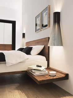 Contemporary timber bedhead.  Unique bedside lights #bedroom #interiordesign                                                                                                                                                     Más