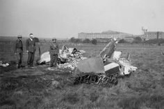 """Acting F/L Geoffrey C """"Geoff"""" Matheson (second left) of No 222 Squadron RAF stands among members of a rescue team by the burnt out wreckage of Spitfire Mk I ZD-D that he crash-landed outside Kemsley near Sittingbourne at 18.10hrs on 30 August 1940. The 28-year-old A Flight leader had claimed an Me 109 when he was shot up by his victim's wingman. The injuries sustained prevented him from flying operationally until 21 September."""