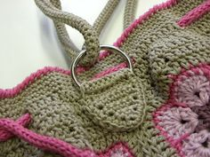 bag handle tabs. Make an oval shape, insert D ring, fold over and sew to bag.