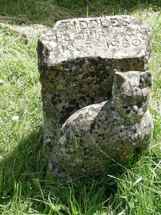 This gravestone to Tiddles the church cat stands in the churchyard of St Mary's Church, Fairford, Gloucestershire.