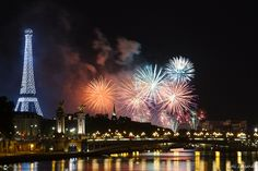 Fireworks during the Bastille Day in Paris with Eiffel Tower, Pont Alexandre III and Trocadero in